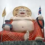 Hymyilevä vaurauden Buddha Thaimaassa