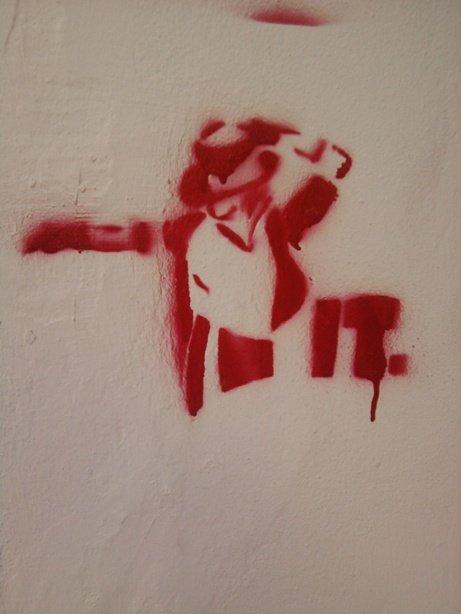Graffitti erään Pohjois-Italialaisen talon seinässä.