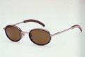 John Lennon. Tuntomerkit: Pyöreät ja metalliset lasit. Johnin lasityyppi oli suosittu viimeksi 1990-luvun alussa.