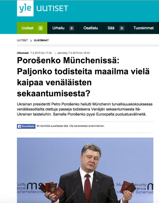 Yle nosti esiin suoraan Reutersin uutisen. Kuvakaappauksessa Ukrainan presidentti Petro Porošenko pitää kädessään venäläisiä passeja.