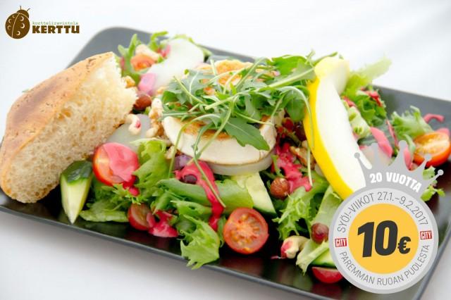 Vuohenjuustosalaatin kruunaa kirpsakka ja makea vadelmavinegretti.