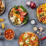 Pizzaa ja wingsejä niin paljon kuin napa vetää – Isoon Omenaan tulee Rax Pizzabuffet